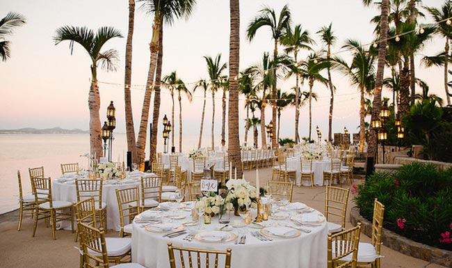 beach wedding palm trees oceanside reception table design ricardo tomas weddings event planner